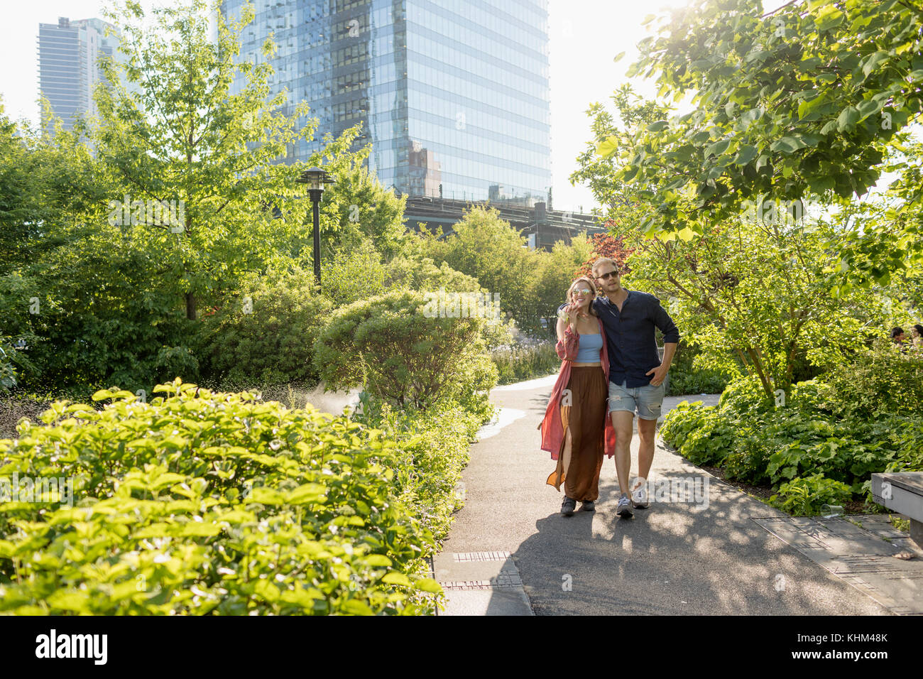 Couple walking together in a park - Stock Image