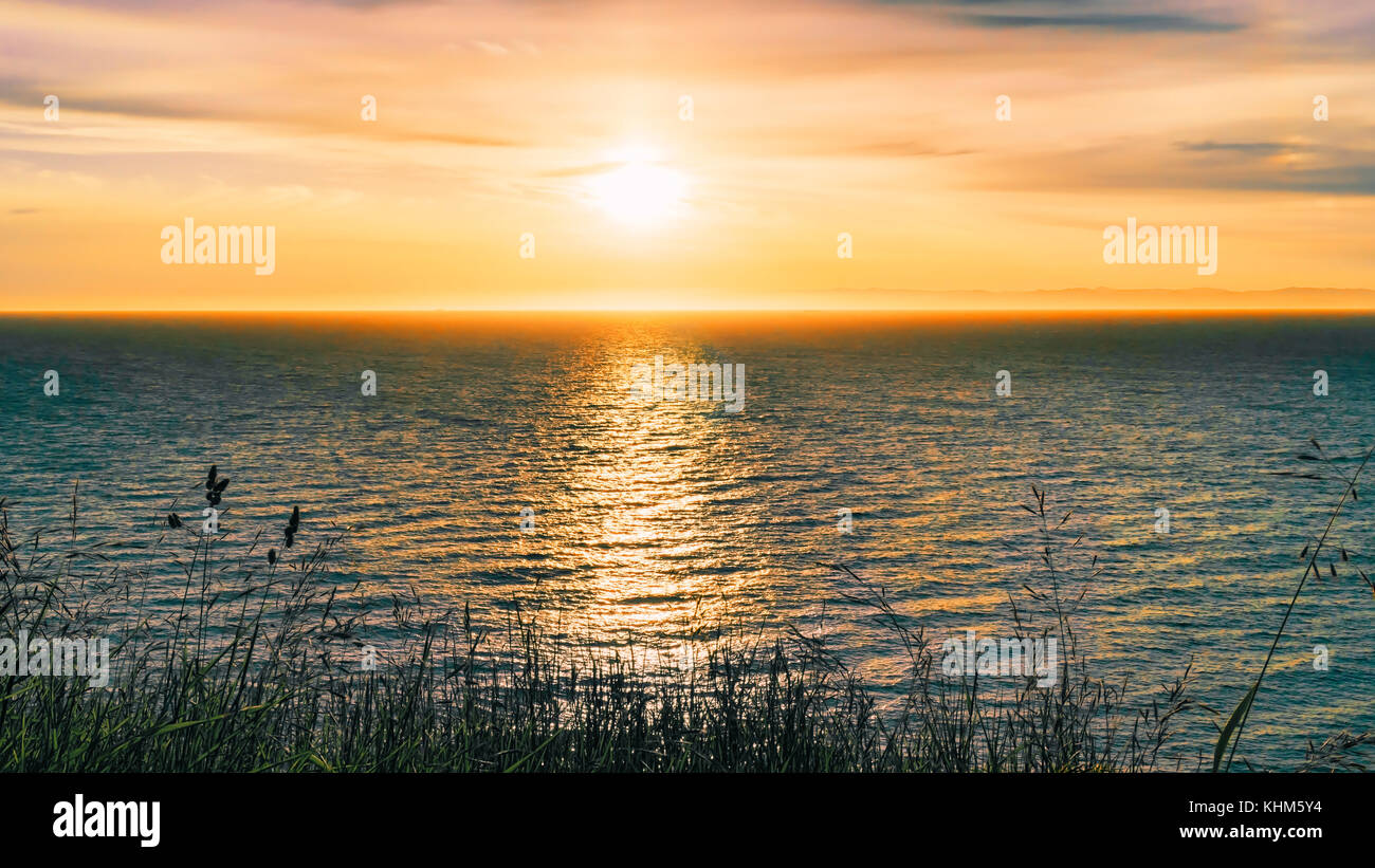 Sunset from Dungeness Recreation Area, a Clallam County park near Sequim in Washington State.  Dungeness Spit, and - Stock Image
