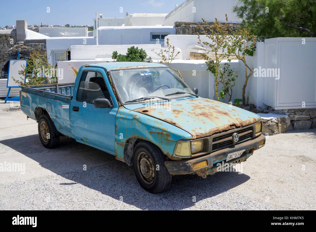 Old rusty Pick-up at Mykonos-town, Mykonos island, Cyclades, Aegean, Greece - Stock Image