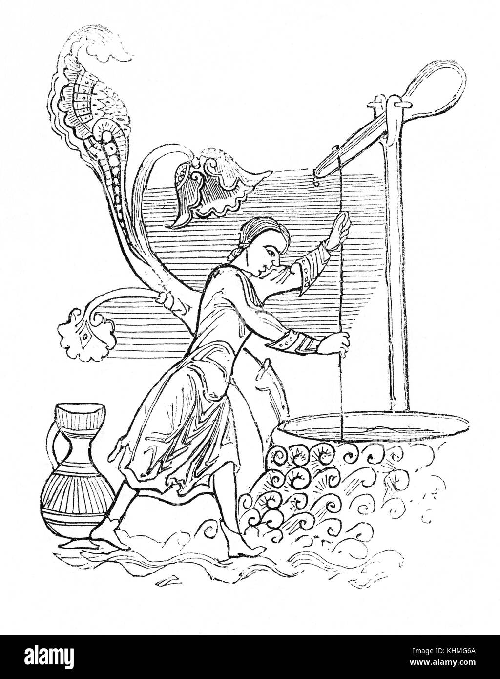 Using basic Anglo Saxon technology, a woman raising water from a well with a loaded lever in 9th Century England - Stock Image