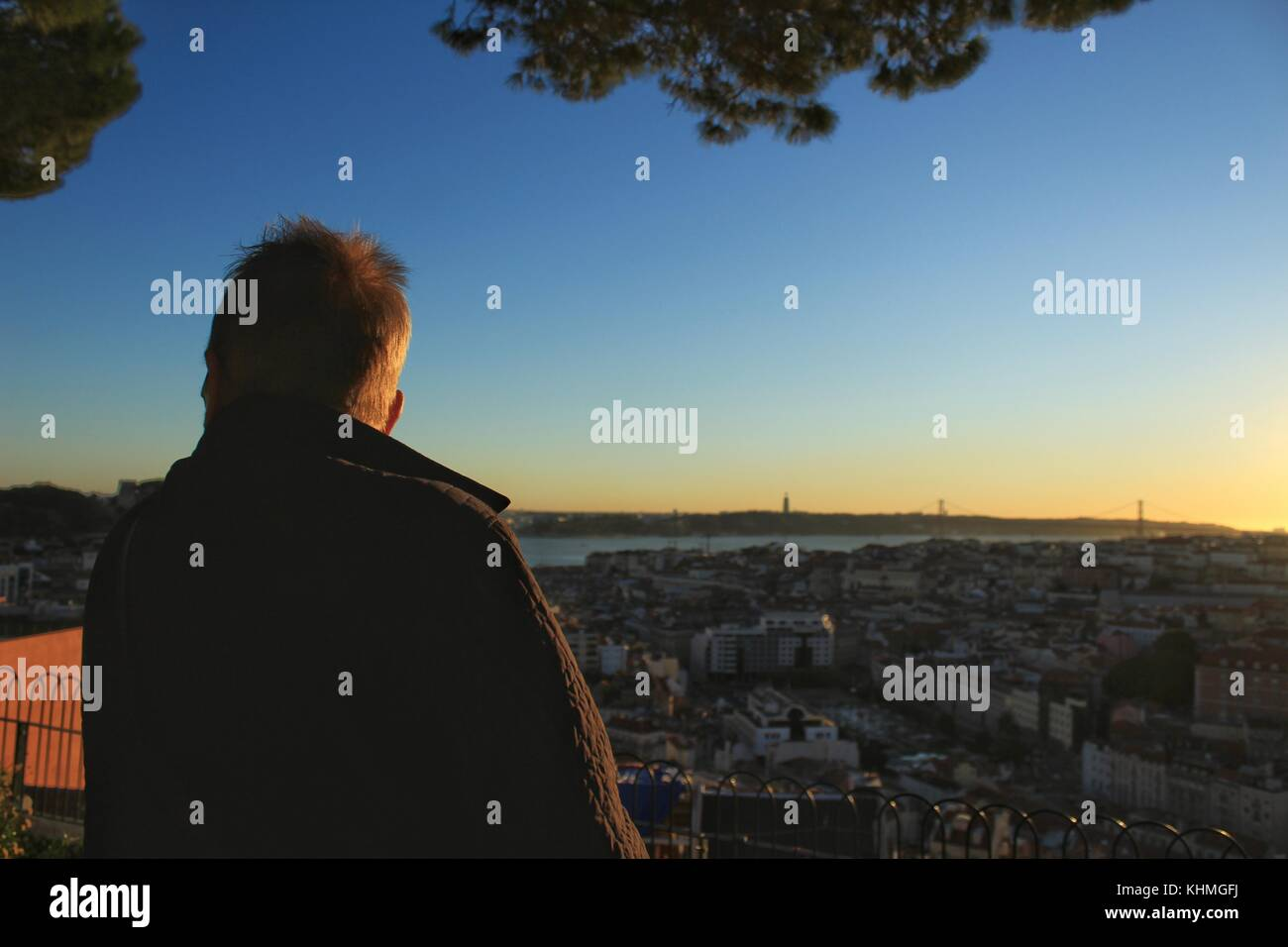 People watching the sunset in a viewpoint of Lisbon in Autumn - Stock Image