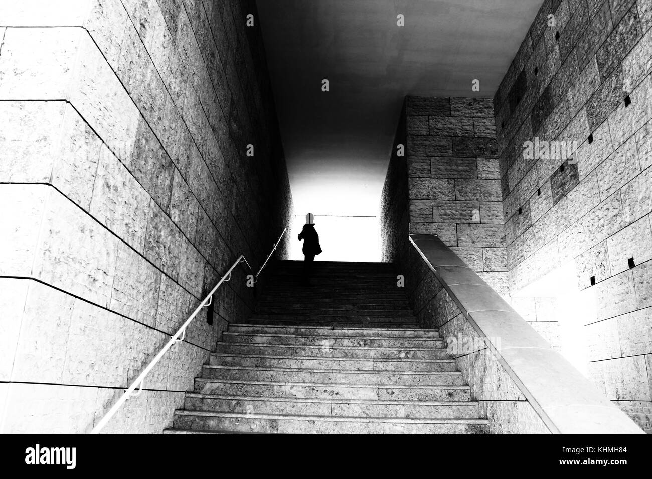Silhouette at the end of the stairs - Stock Image