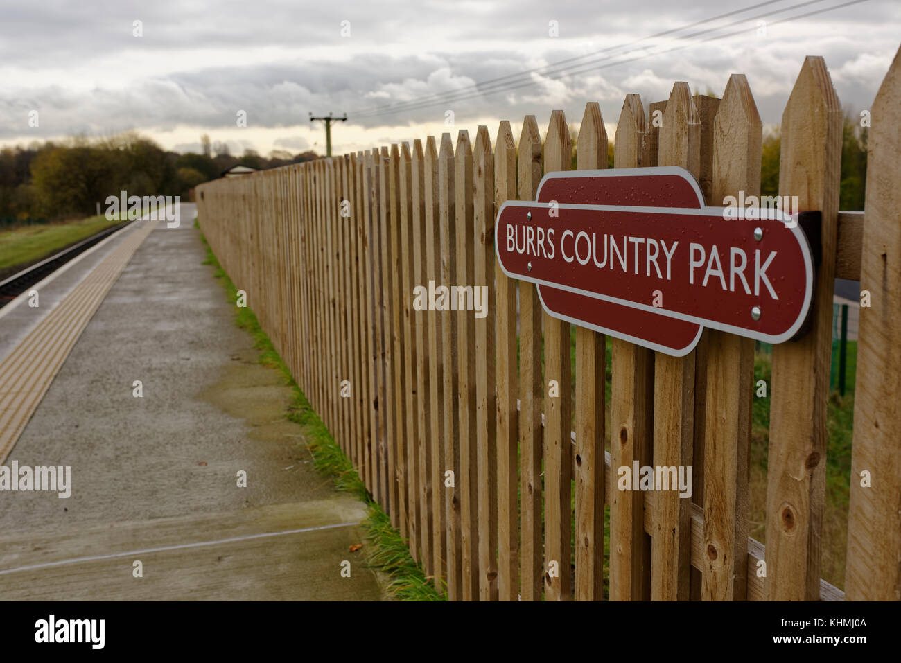 Burrs country park totem railway sign mounted on wooden fencing on the east lancashire railway station platform Stock Photo
