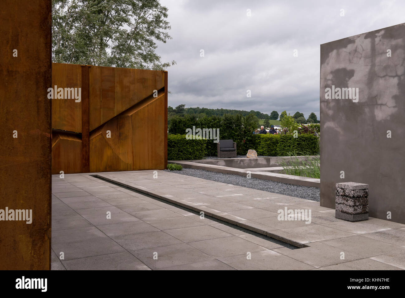 Seating area, concrete & wall sculpture in Brutalist inspired IQ Quarry garden - RHS Chatsworth Flower Show, - Stock Image