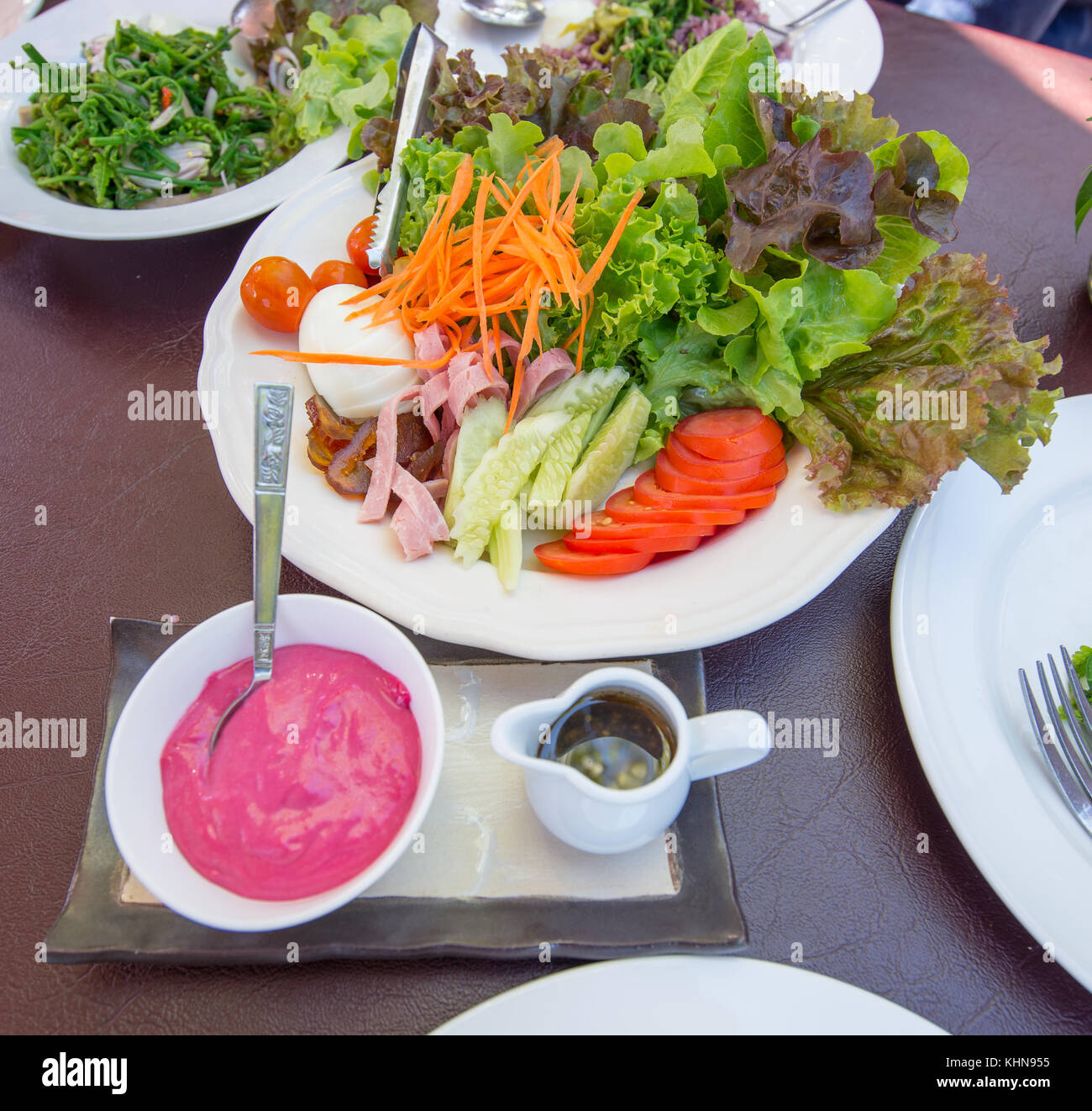 Egg Salad on a table with raspberry cream sauce, Thailand style - Stock Image