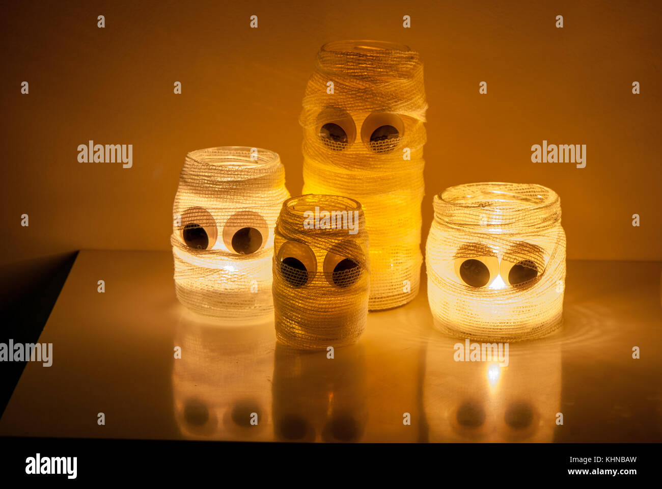 dolls made with glass jars and a candle inside, decorated with bandages, made for Halloween - Stock Image