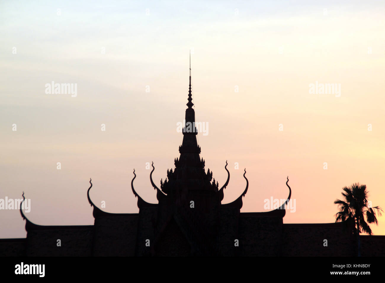 Silhouete of pagoda and palm tree in Cambodia - Stock Image