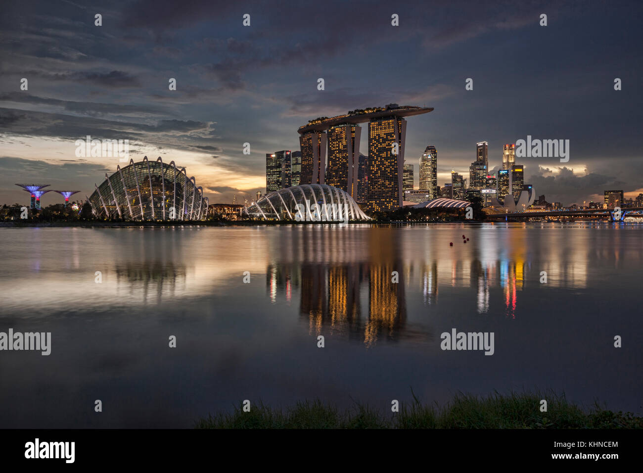 Singapore skyline reflected in Marina Bay, with Supertrees, the Cloud and Flower Domes, Marina Bay Sands and the - Stock Image