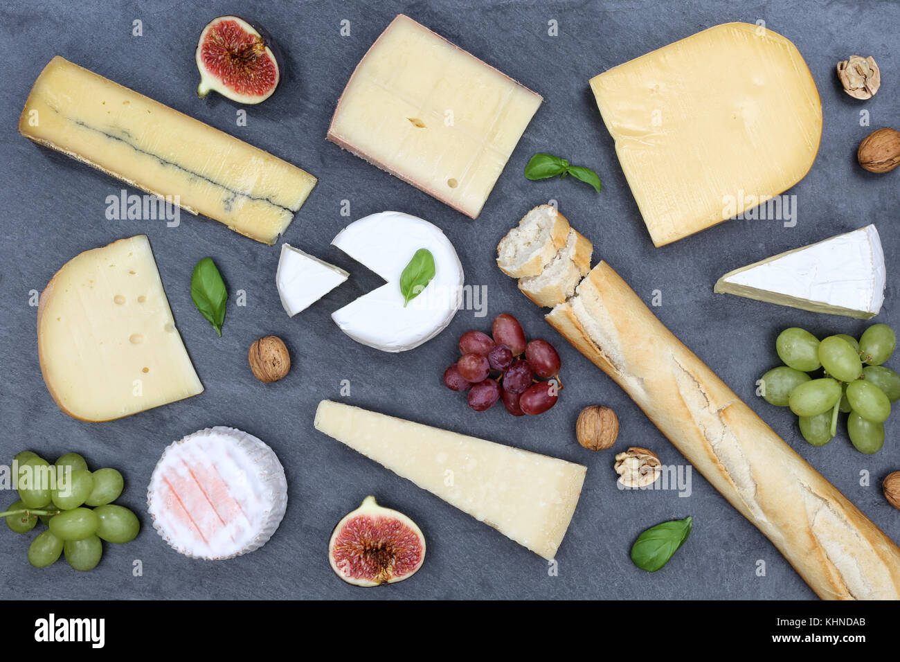 Cheese board platter plate Swiss bread Camembert slate top view from above - Stock Image