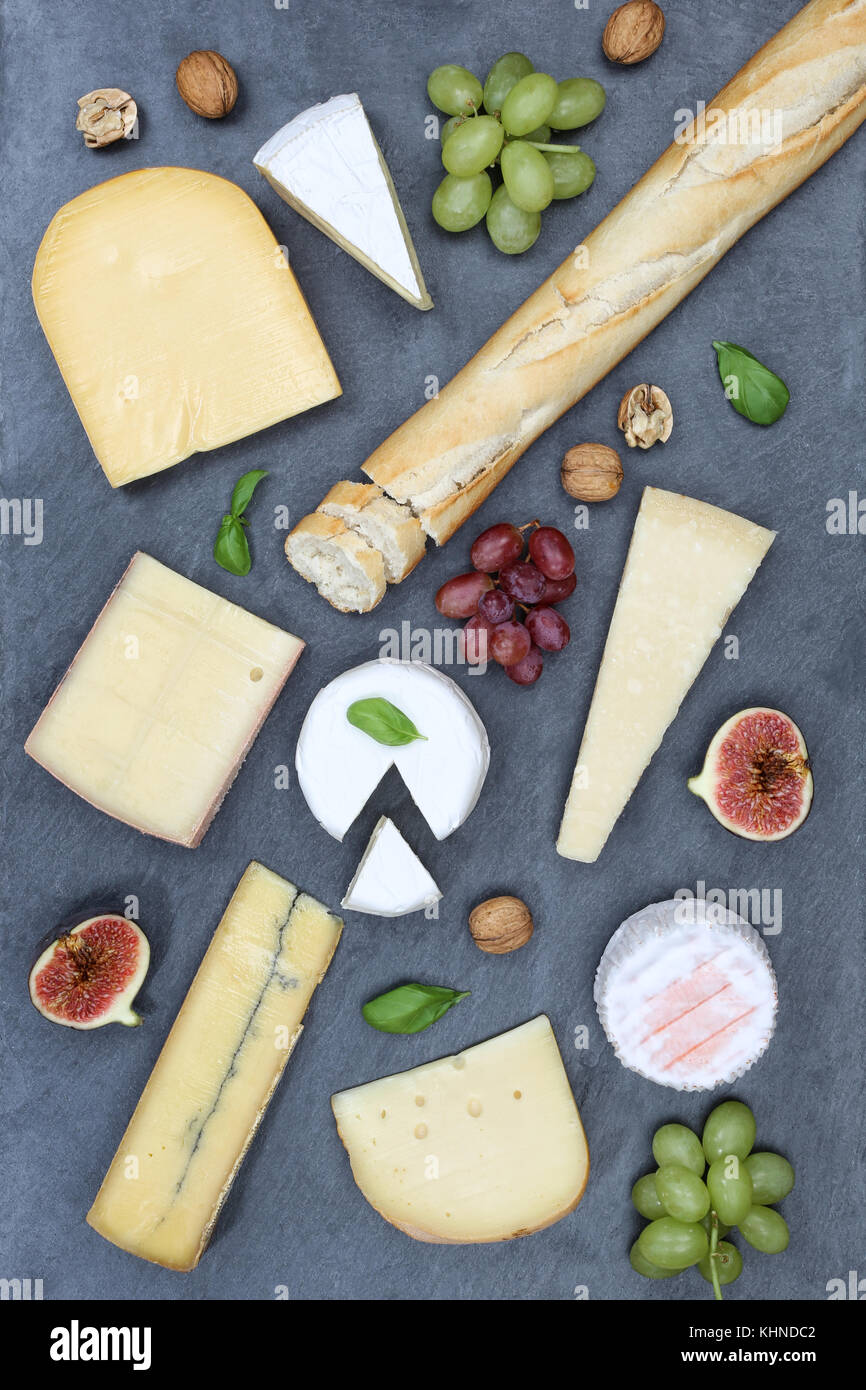 Cheese board platter plate Swiss bread Camembert portrait format slate top view from above - Stock Image