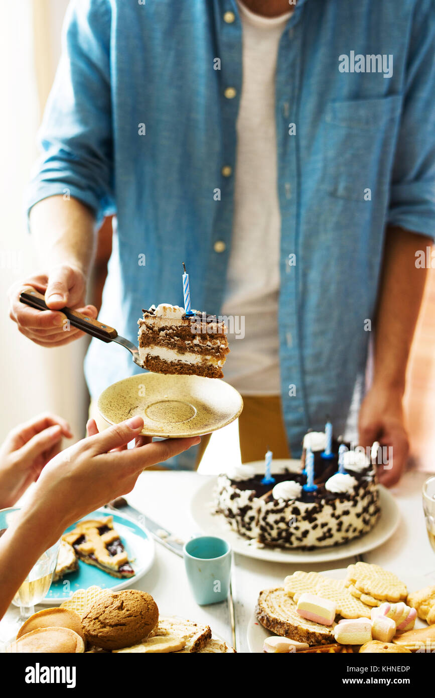 Pleasing Guy Putting Piece Of Birthday Cake With Blown Candle On Saucer Of Personalised Birthday Cards Beptaeletsinfo