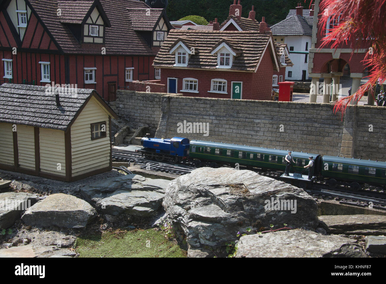 Train passing through village Bekonscot Model Village Beaconsfield Buckinghamshire England - Stock Image