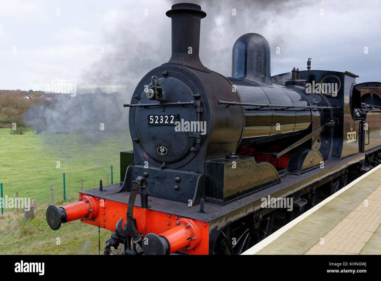 Steam train, black 0 6 0 locomotive waiting to depart from burrs country park railway station bury lancashire uk - Stock Image