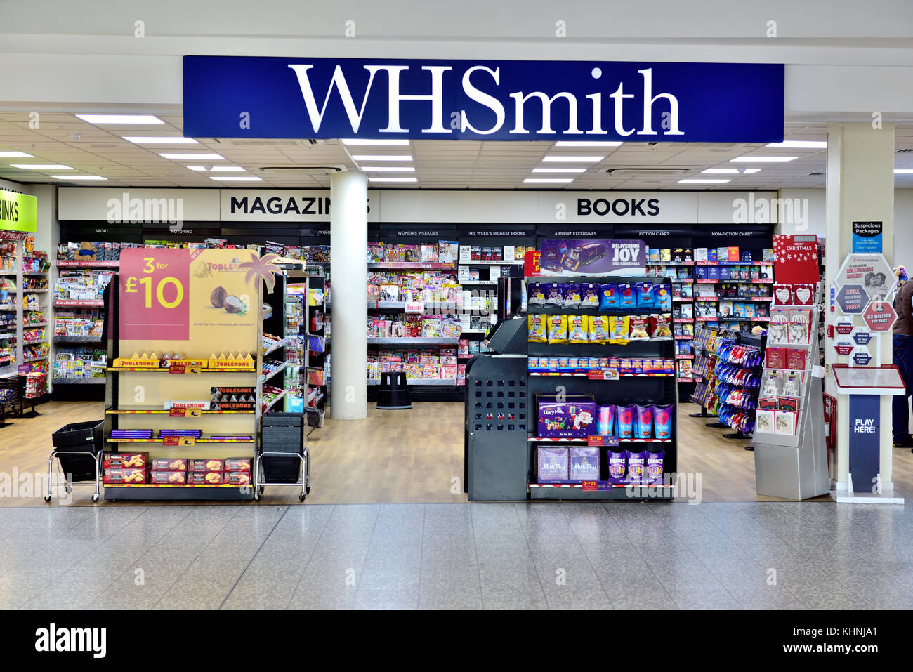 WH Smith newsagents store with sign in airport - Stock Image