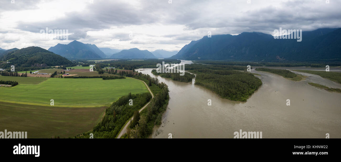 Aerial view of the Farm lands, fraser river and the beautiful mountain landscape. Taken in Agassiz, British Columbia, - Stock Image