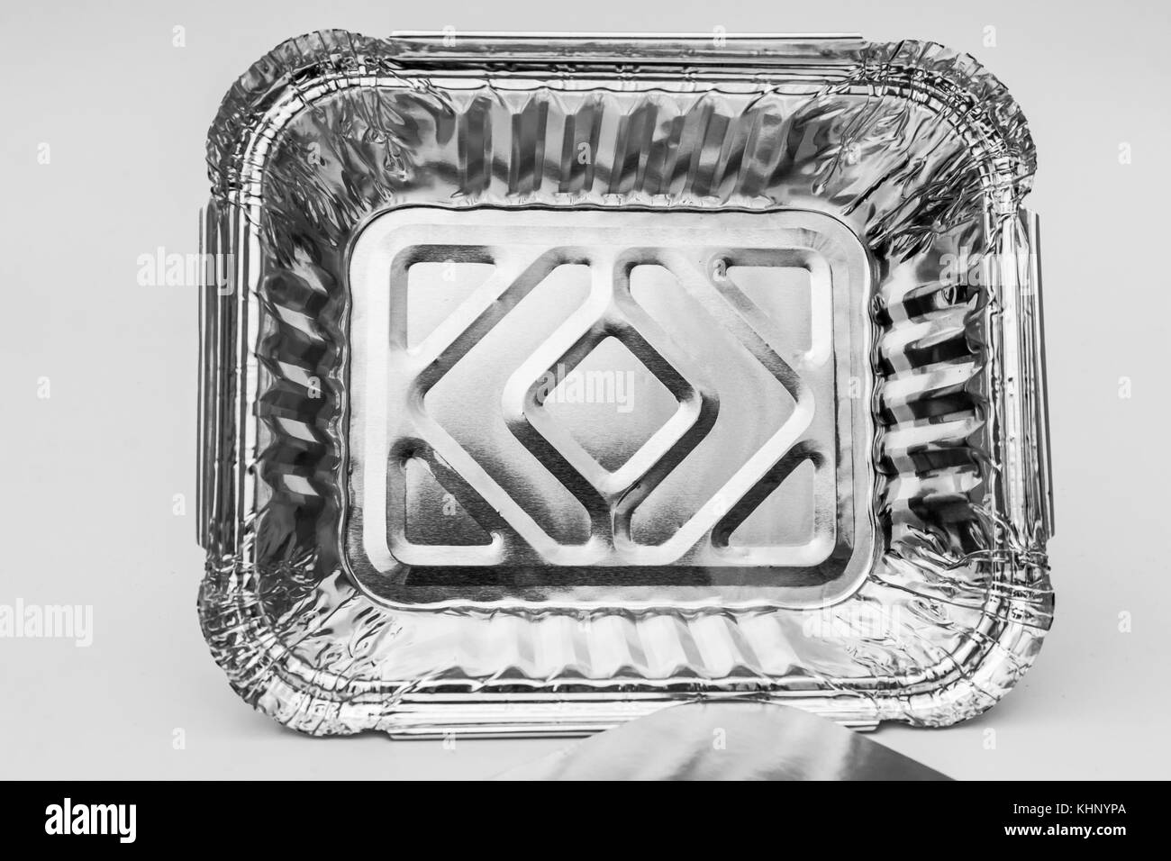 A view of a Tin Foil Dish as used for catering and in  kitchens for storing and cooking food - Stock Image