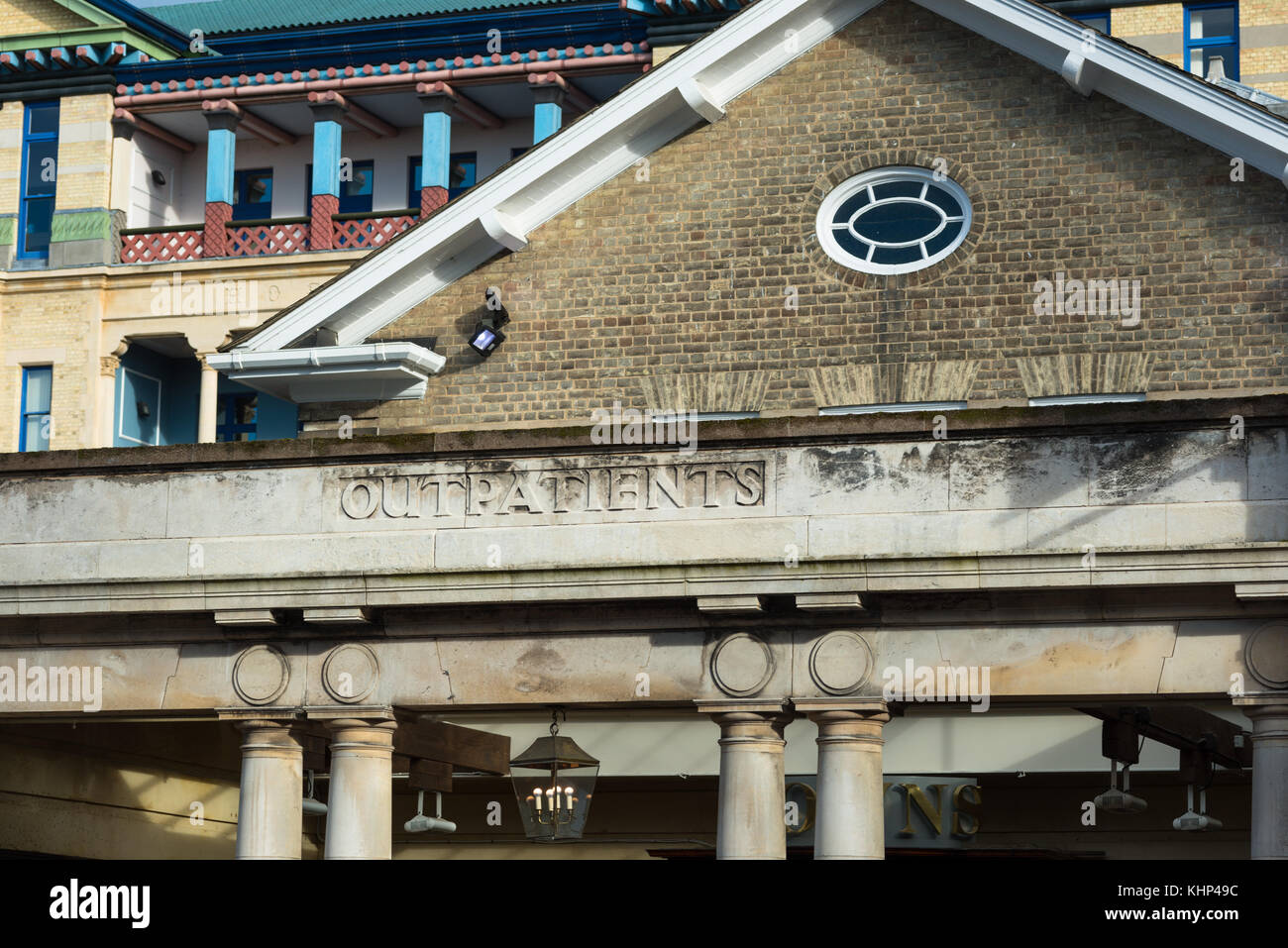 Outpatients sign of old Addenbrookes hospital building, now transformed into a bar. Cambridge, England, UK. - Stock Image