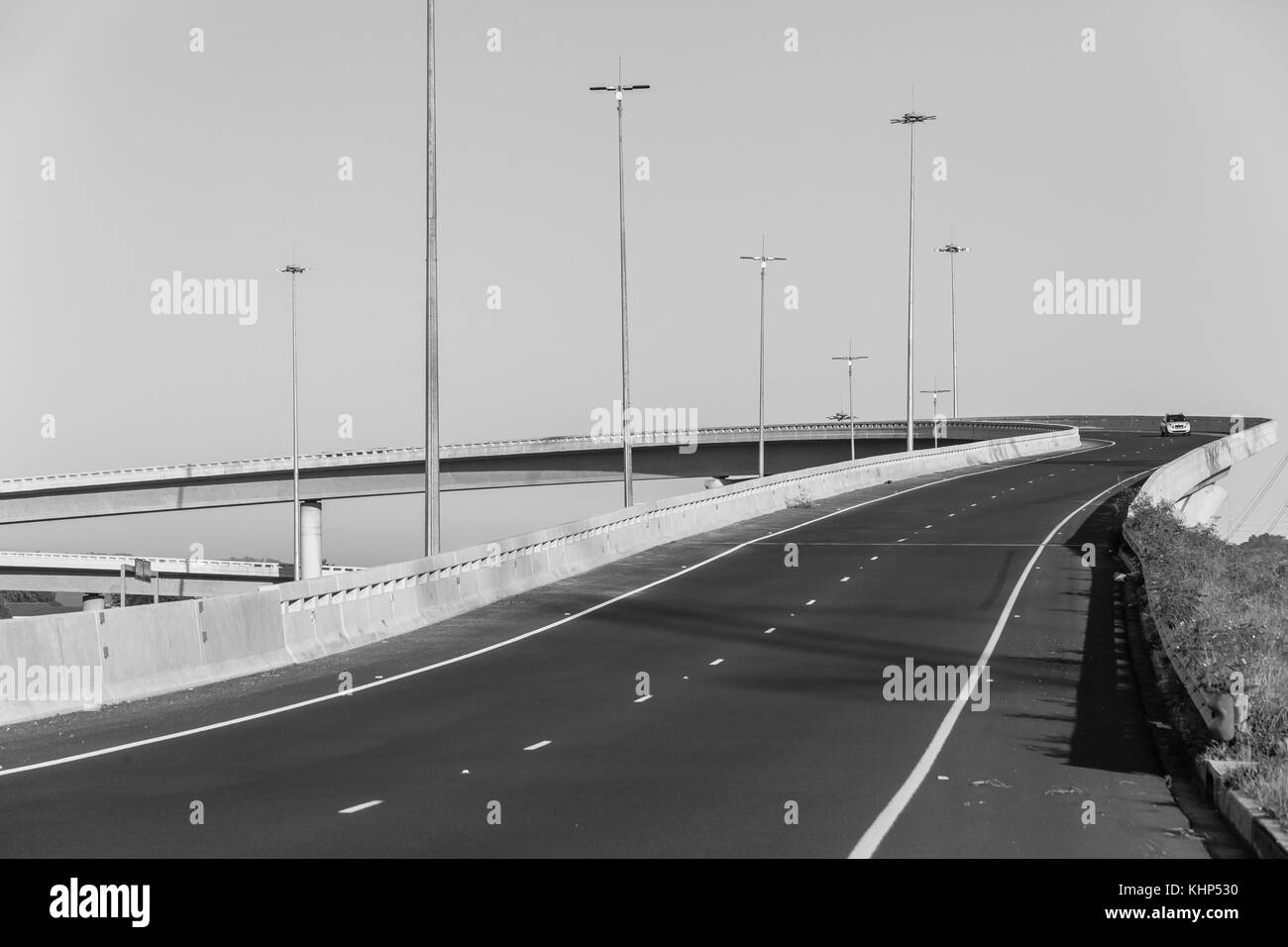 Road highway overhead flyover ramp entry exit structures in black and white. - Stock Image