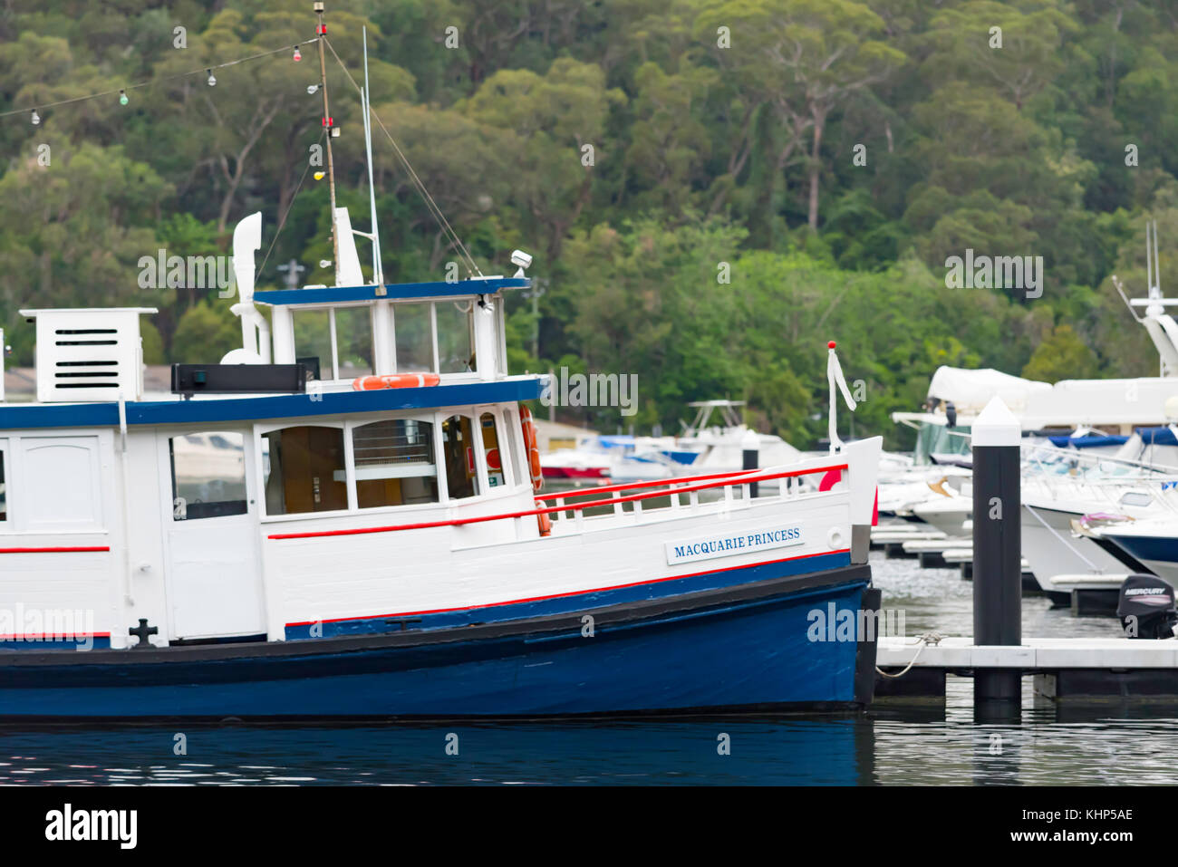 A historic wooden ferry moored at Berowra Waters in Sydney - Stock Image