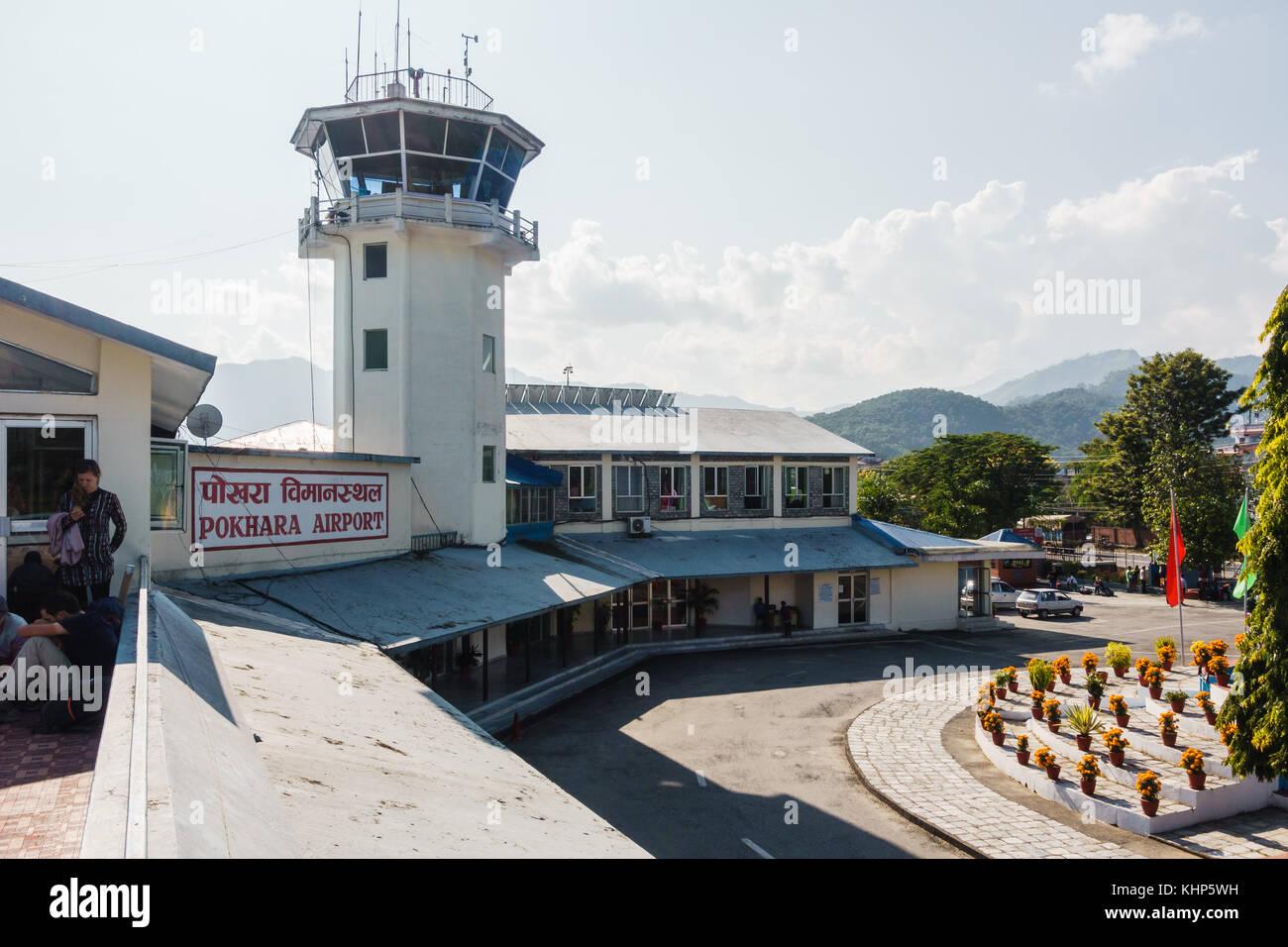 POKHARA, NEPAL - CIRCA NOVEMBER 2017: Pokhara airport and its air traffic control tower. - Stock Image