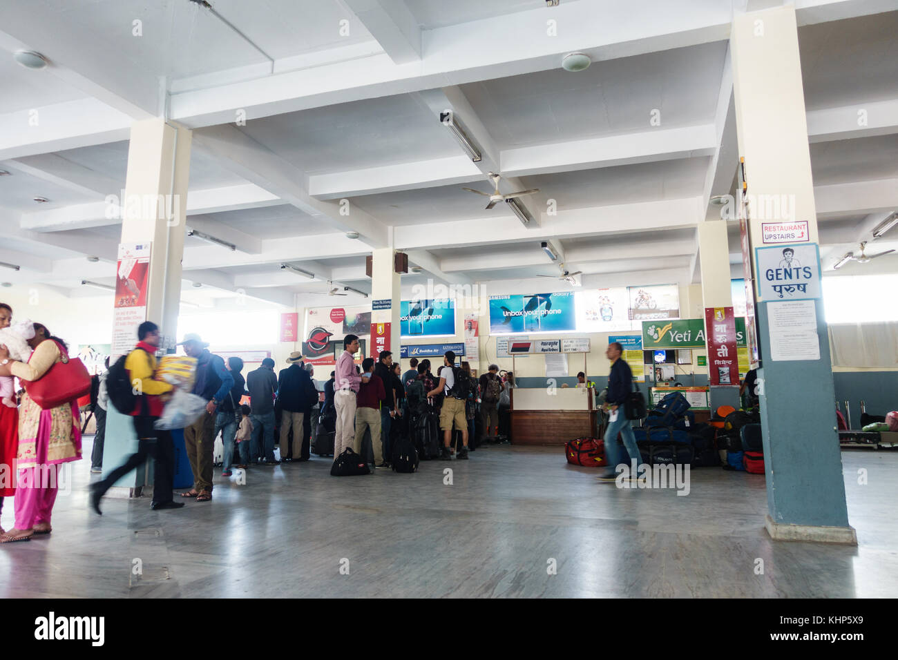 POKHARA, NEPAL - CIRCA NOVEMBER 2017: People are queuing to check in at Pokhara airport. - Stock Image