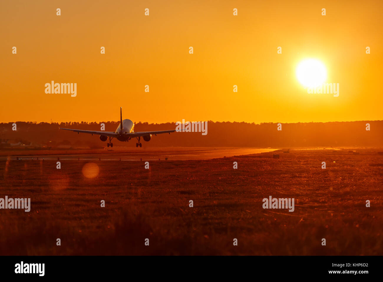 Airplane landing airport sun sunset vacation holidays travel traveling plane aircraft travelling - Stock Image