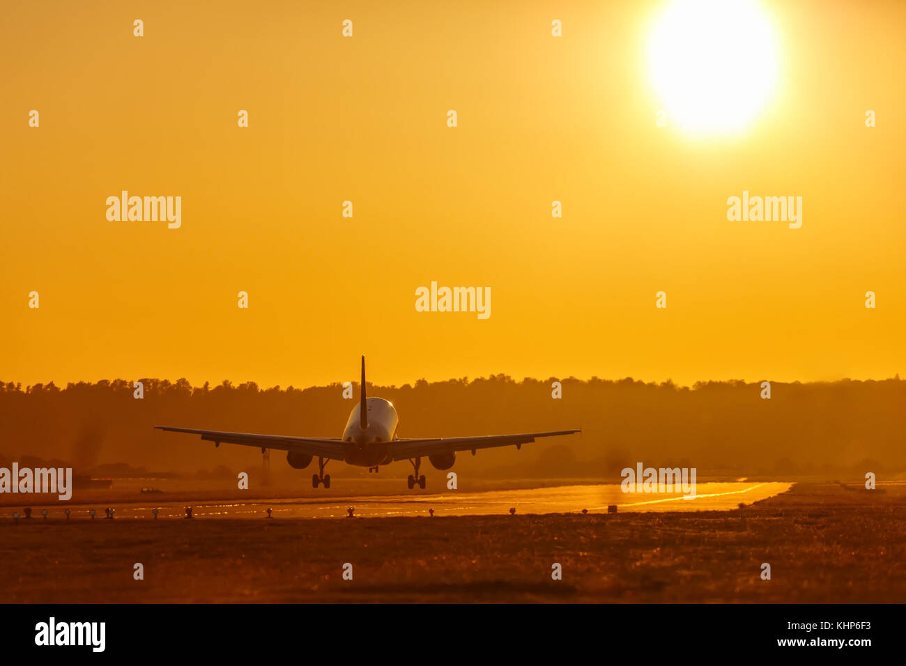 Vacation holidays travel airplane landing airport sun sunset plane aircraft travelling - Stock Image