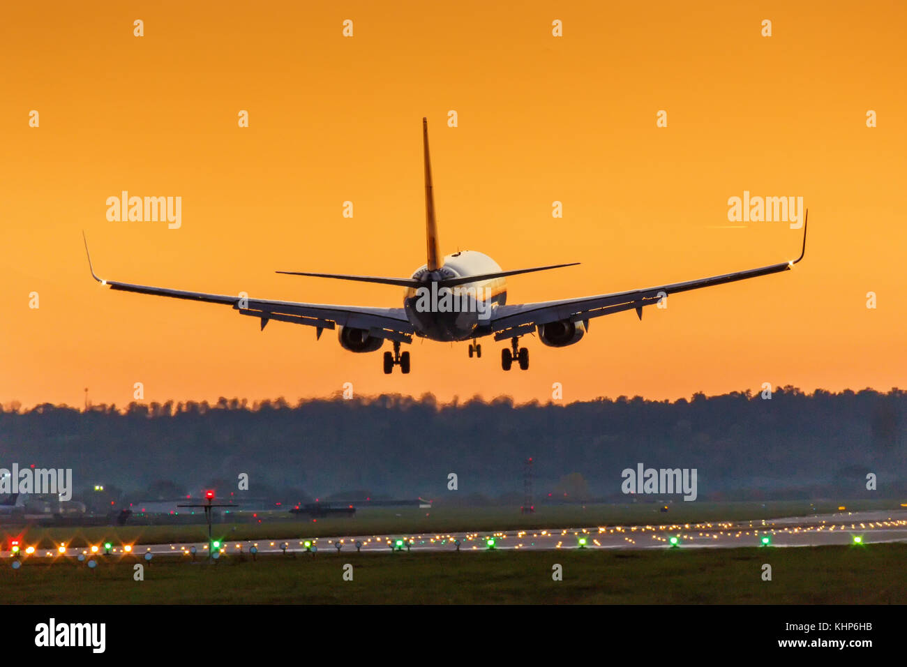 Airplane landing Stuttgart airport sun sunset vacation holidays travel traveling plane aircraft travelling - Stock Image