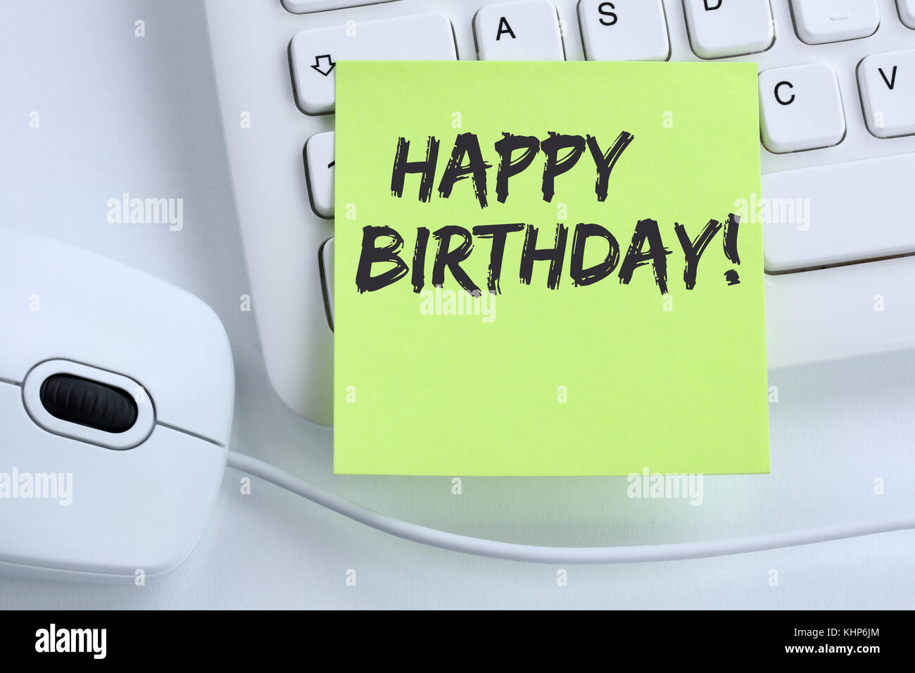 Happy Birthday greetings celebration business concept mouse computer keyboard - Stock Image