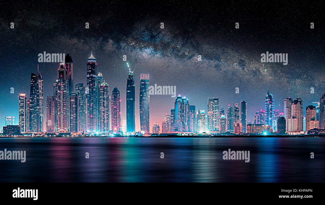 Dubai city under the milky way - Stock Image