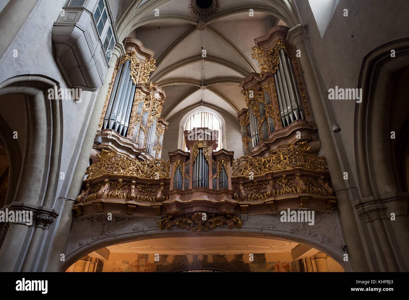 St. Michael's Church (German: Michaelerkirche) interior in Vienna, Austria, gilded pipe organ from 1714 by Johann - Stock Image
