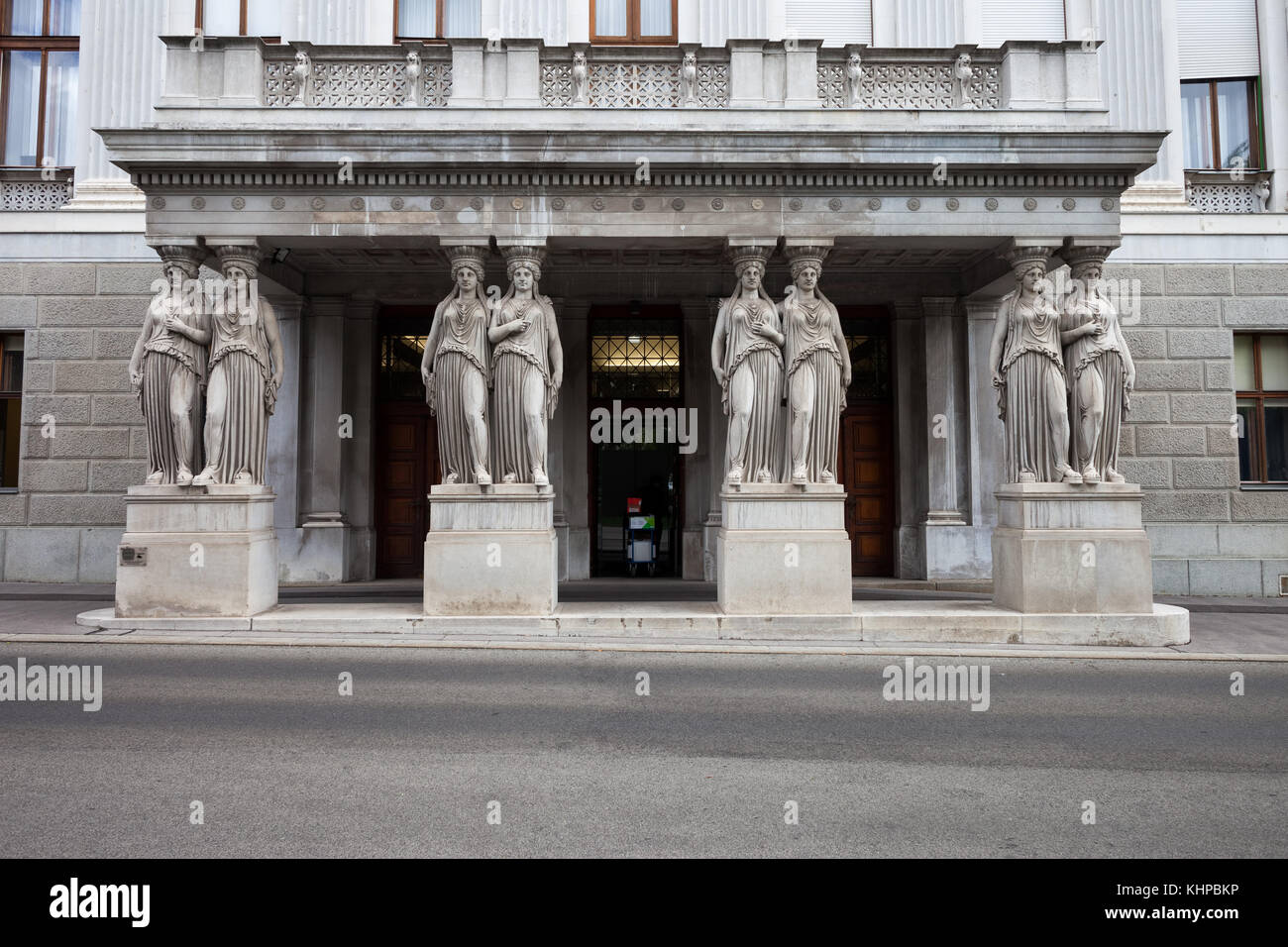 Caryatids ancient Greek female figures as entablature supporting columns, side entrance to the Austrian Parliament - Stock Image