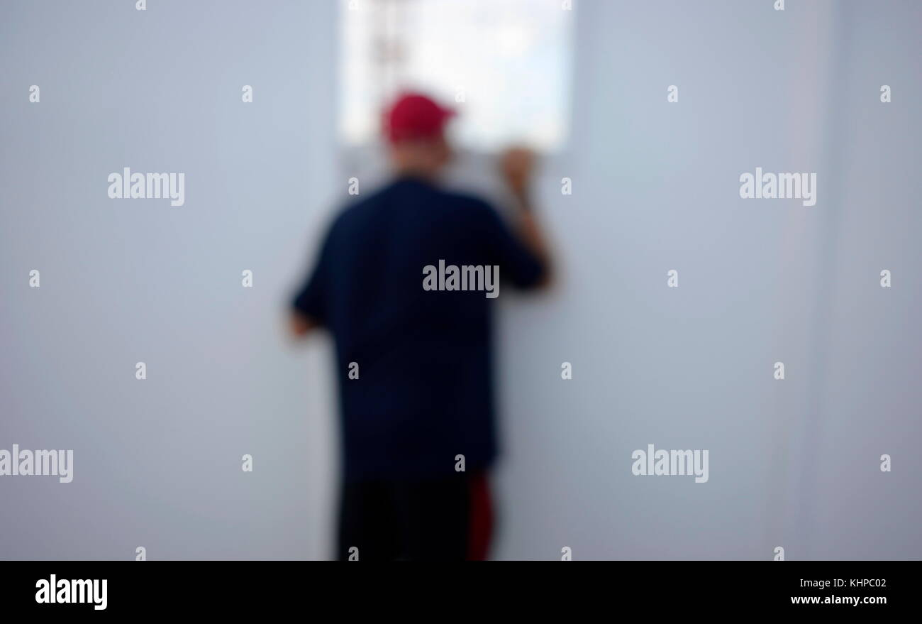 AJAXNETPHTO. MAY, 2013. WORTHING, ENGLAND. - BLURRED VIEW - MAN LOOKS THROUGH THE WINDOW OF A BUILDING SITE. PHOTO:JONATHAN - Stock Image
