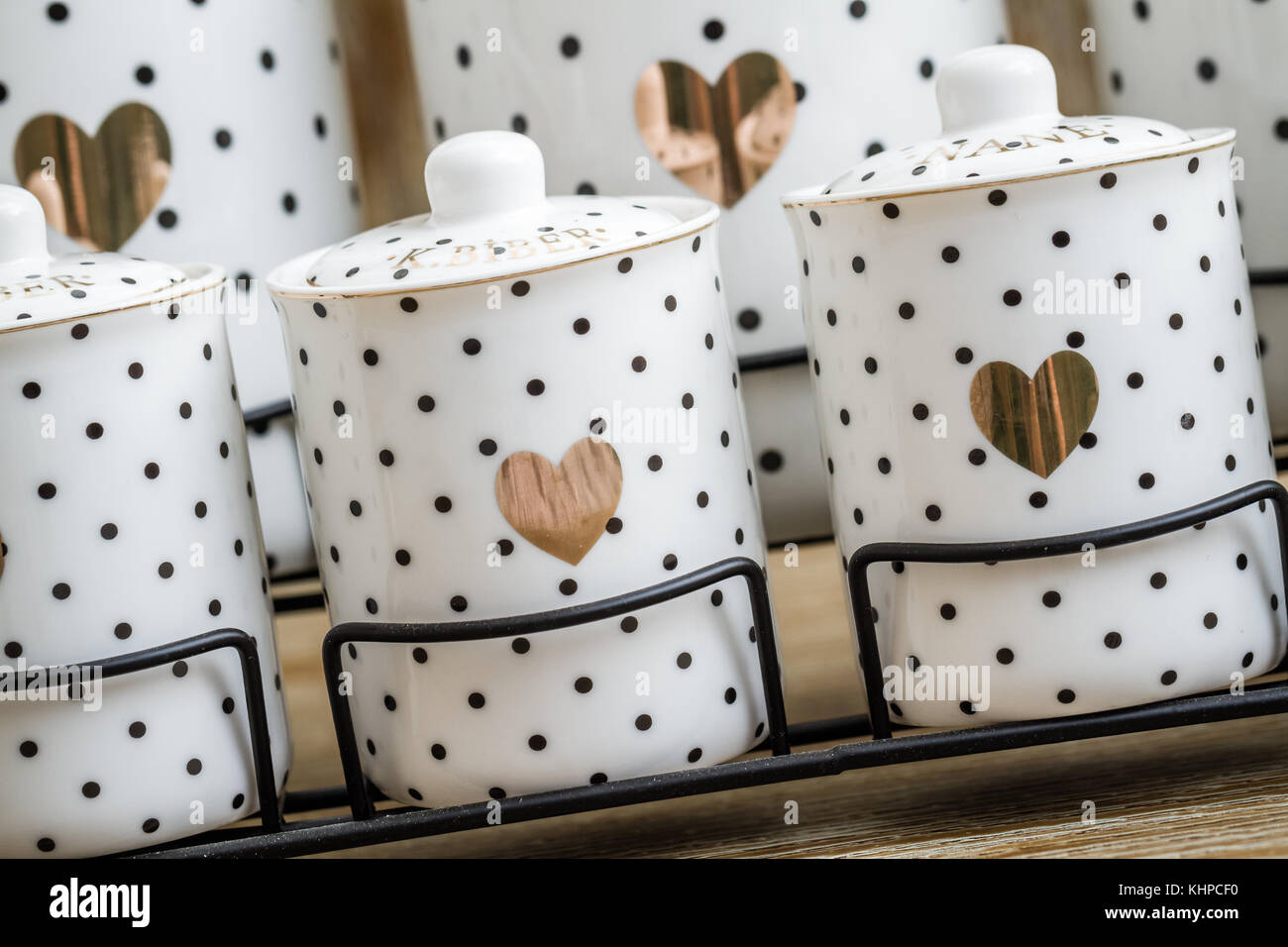 Black dotted white porcelain spice jars with heart pattern