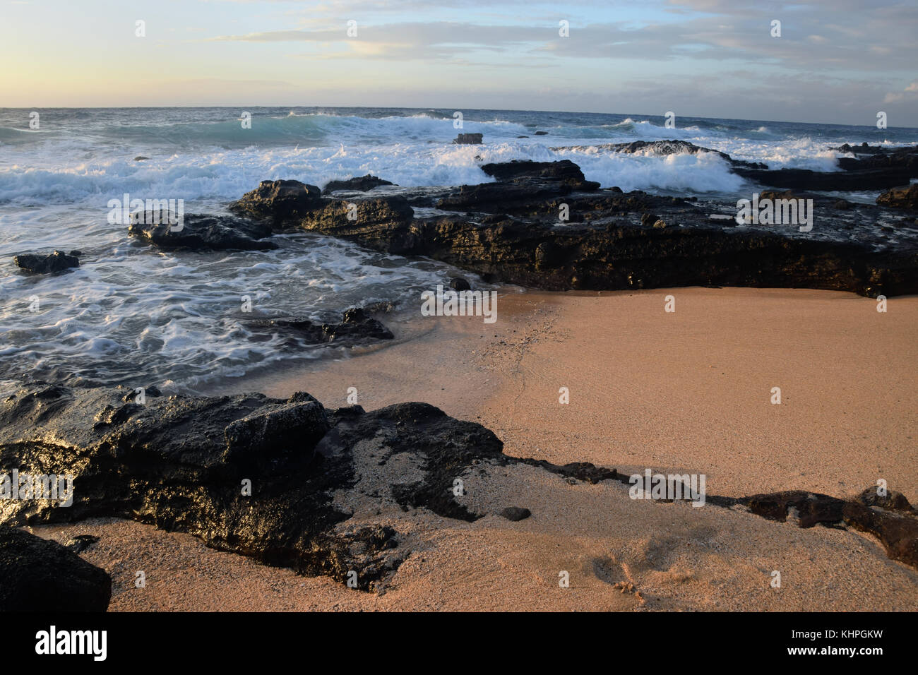 Sunrise over Sandy Beach - Oahu, Hawaii - Stock Image