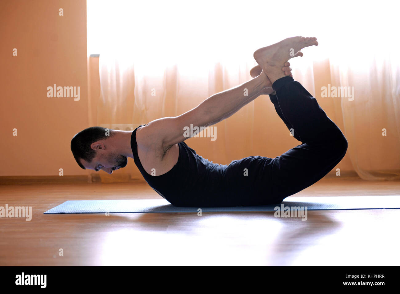 Yoga instructor teaches yoga poses in a studio, demonstration for mass media. May 3, 2016. Dmitriy Goncharenko's - Stock Image