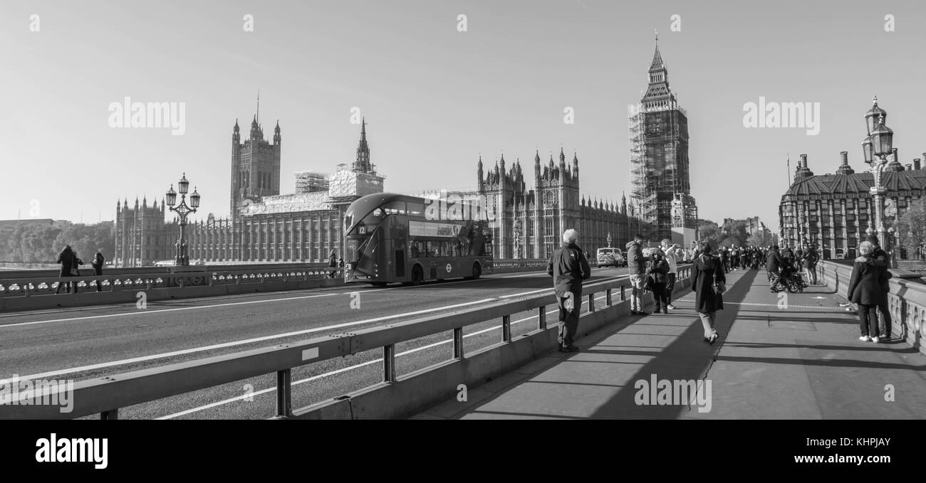 LONDON, UK - October 17th, 2017: Westminster bridge and big ben renovation scaffolding construction with the house - Stock Image