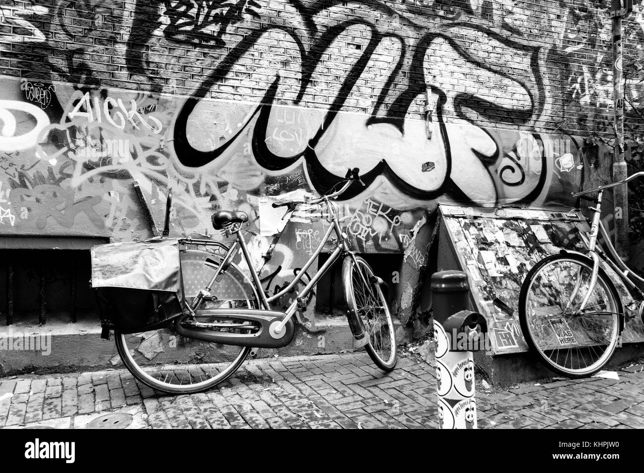 Traditional dutch bicycle parked on near brick wall in Amsterdam - Stock Image