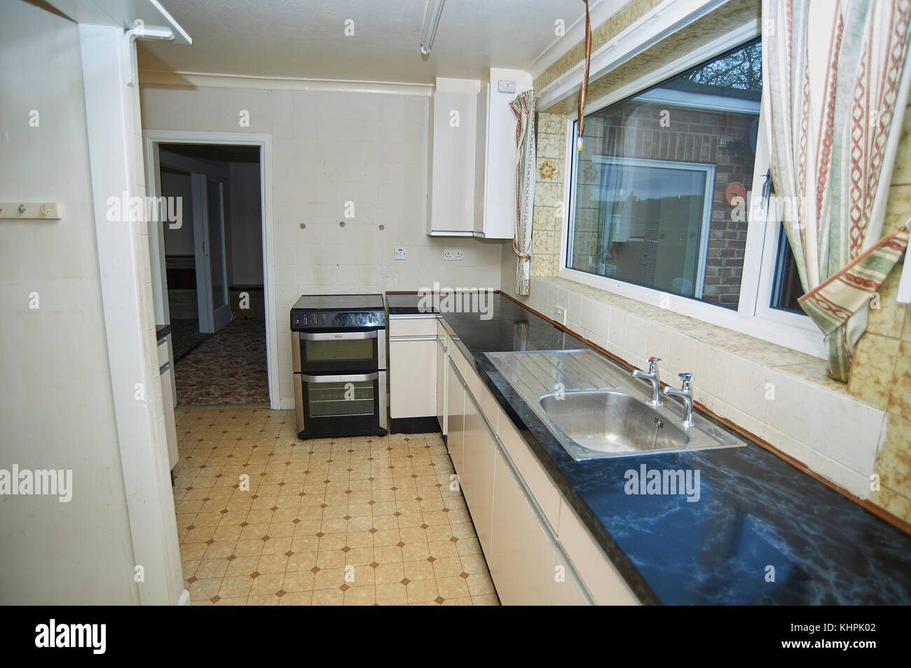 Residential property renovation, renewed fitted kitchen with kitchen units and cooker Stock Photo