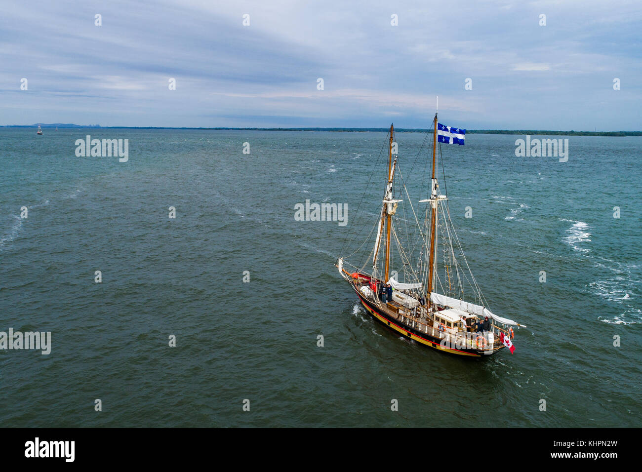 Tall ship approching Port of Montreal on the St-Lawrence River - Stock Image