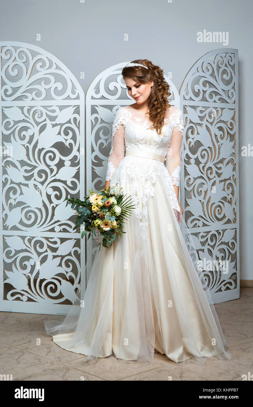 Beautiful Dark Hair Young Woman In Champagne Color Wedding Gown