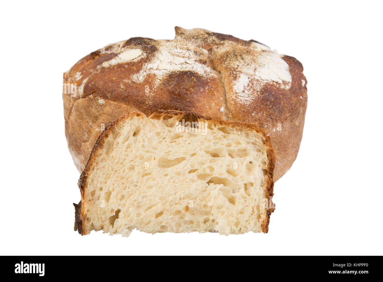 A fresh baked loaf of round artisan sour dough bread on isolated background. - Stock Image