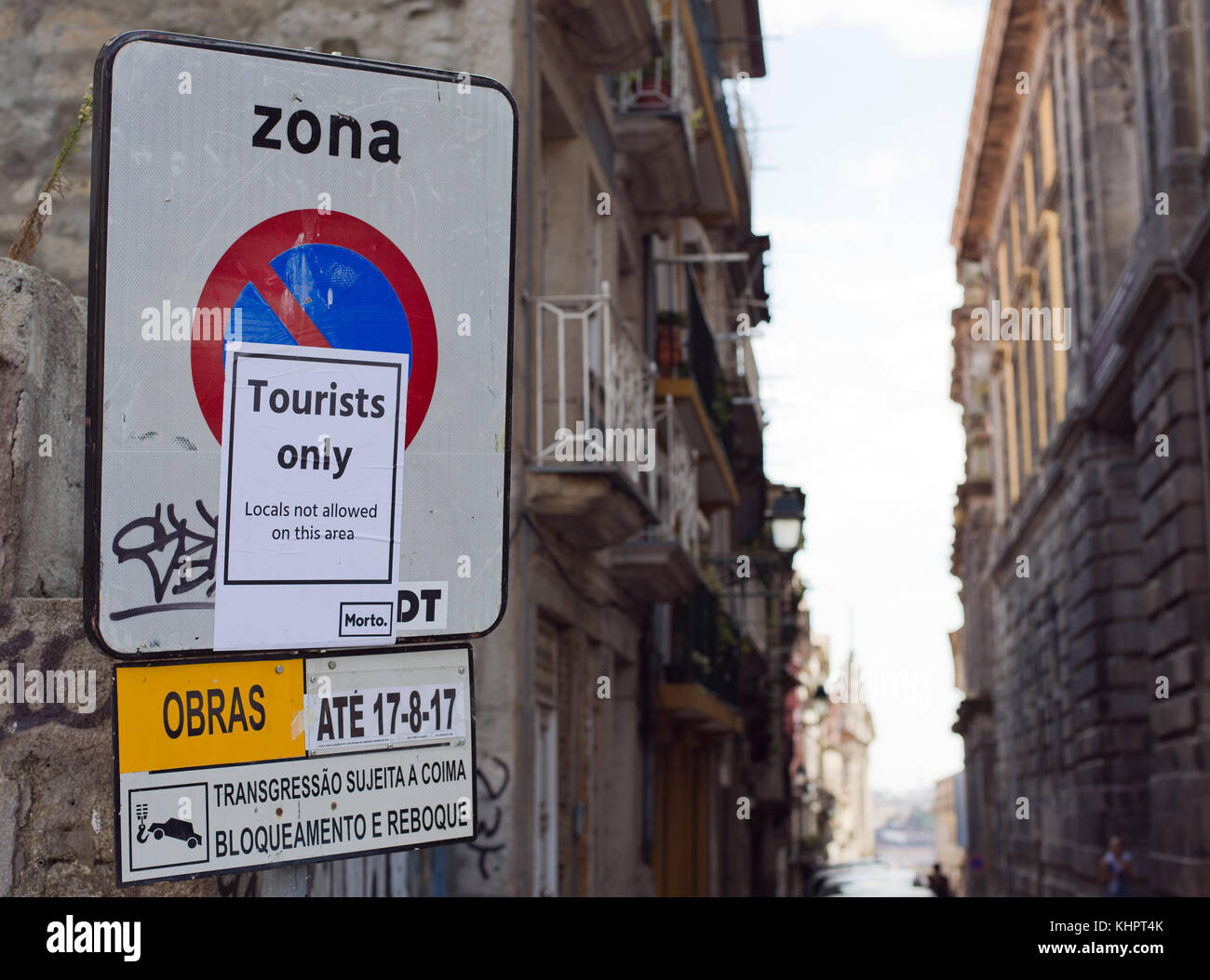 Road signs and protest posters on the street of R. de São Bento da Vitória in the historical old town - Stock Image