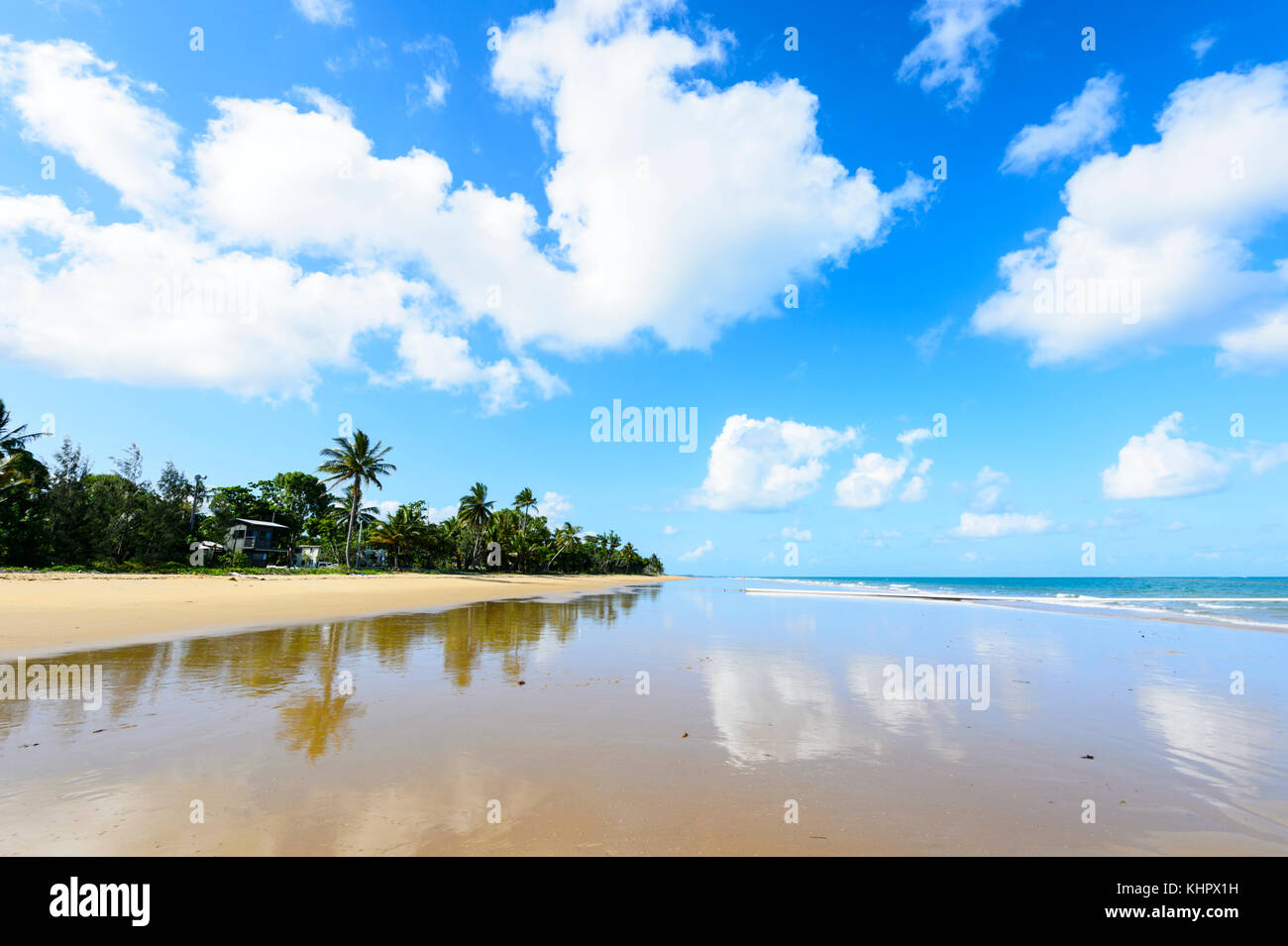 Palm-fringed deserted sandy beach of South Mission Beach on the Coral Sea, Far North Queensland, FNQ, Australia - Stock Image