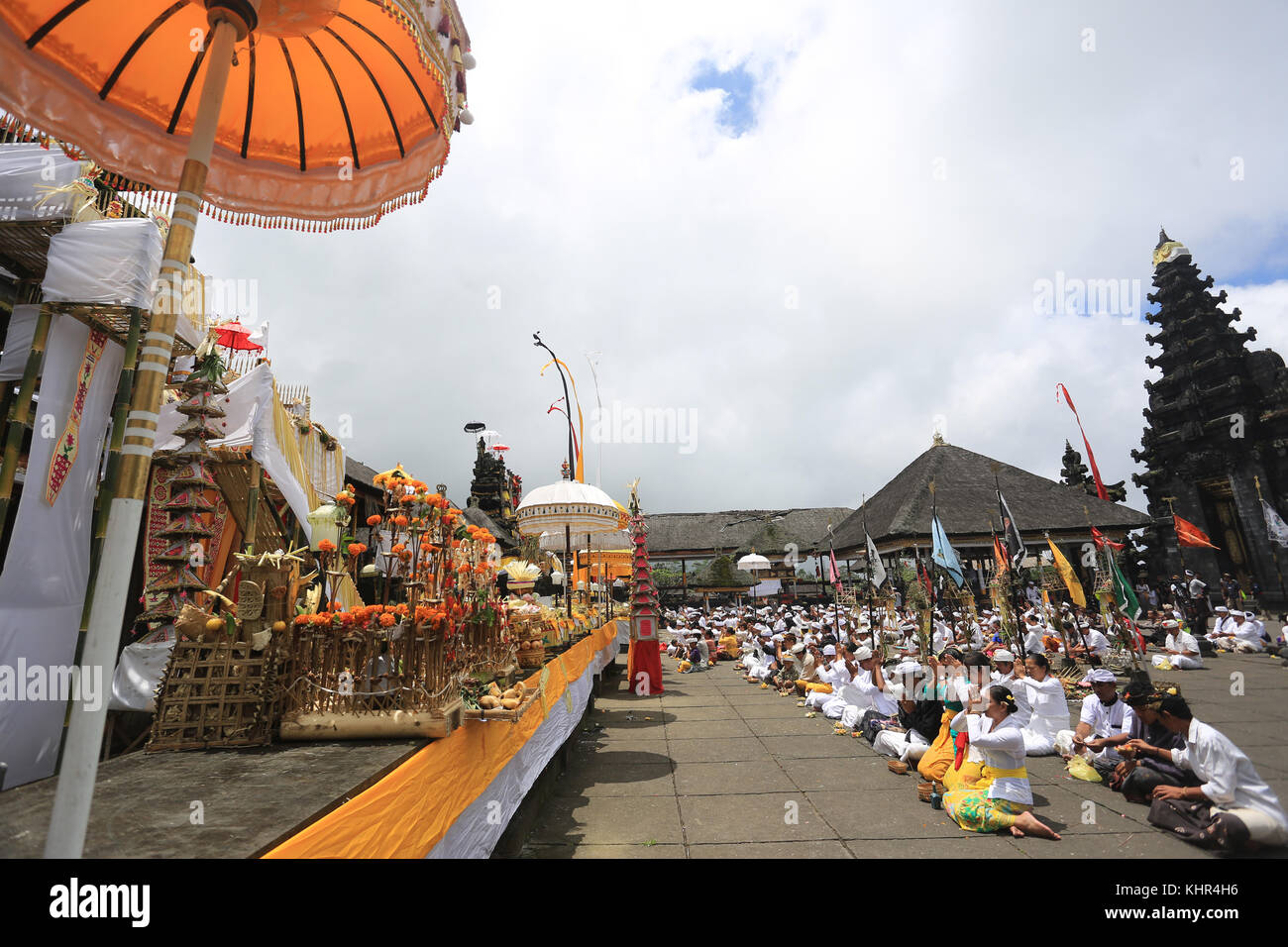 Balinese prayed at a revered Hindu temple on the slopes of Bali's menacing Mount Agung volcano, hoping the gods - Stock Image