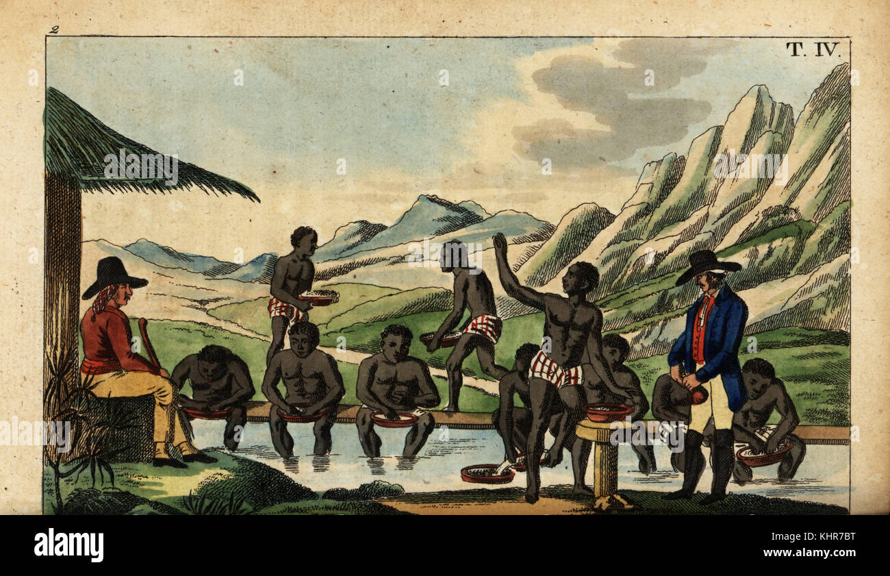 African slaves washing for diamonds guarded by overseers with guns in Brazil. Handcoloured copperplate engraving - Stock Image