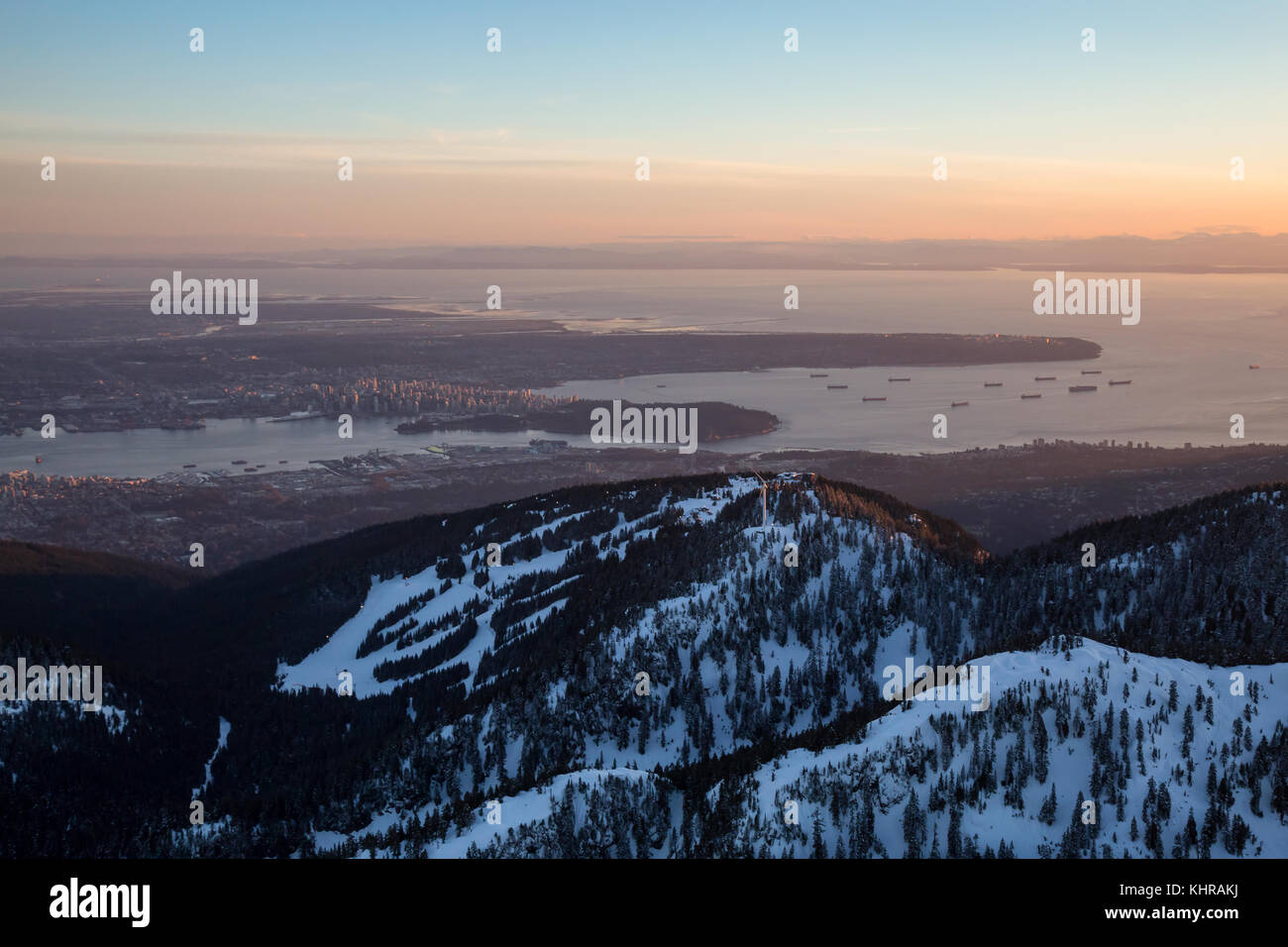 Beautiful Winter Sunset Of Grouse Mountain With Vancouver City In The Background Picture Taken From An Aerial Perspective BC Canada