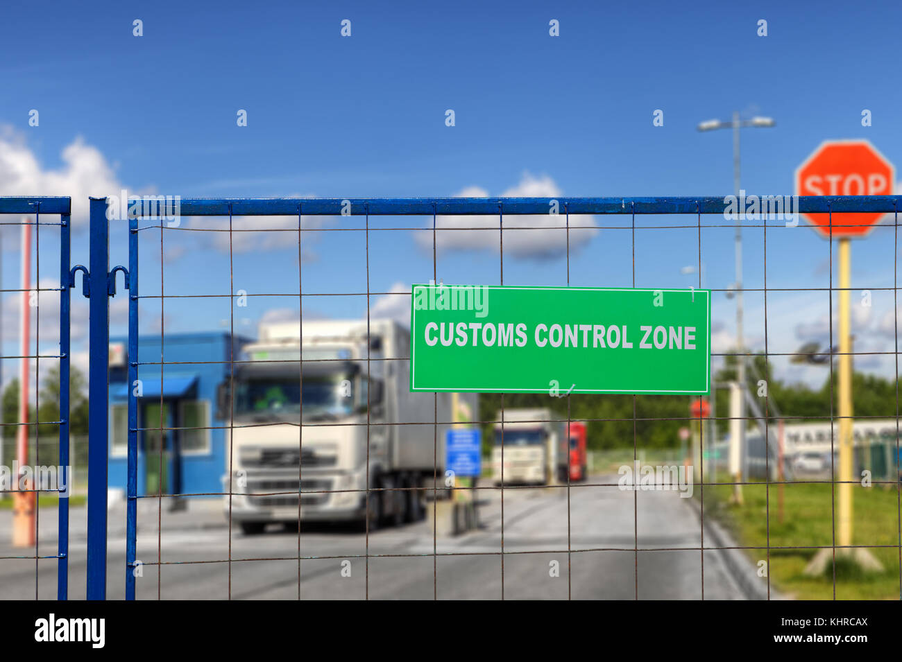 Trucks pass through the checkpoint of the customs logistics terminal. - Stock Image