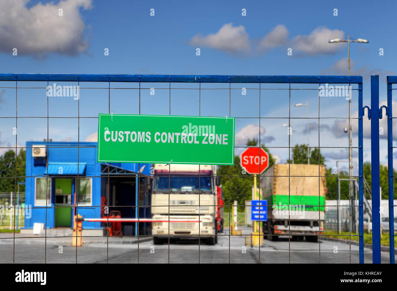 Lorries pass through the security checkpoint of the logistics complex with customs services. - Stock Image