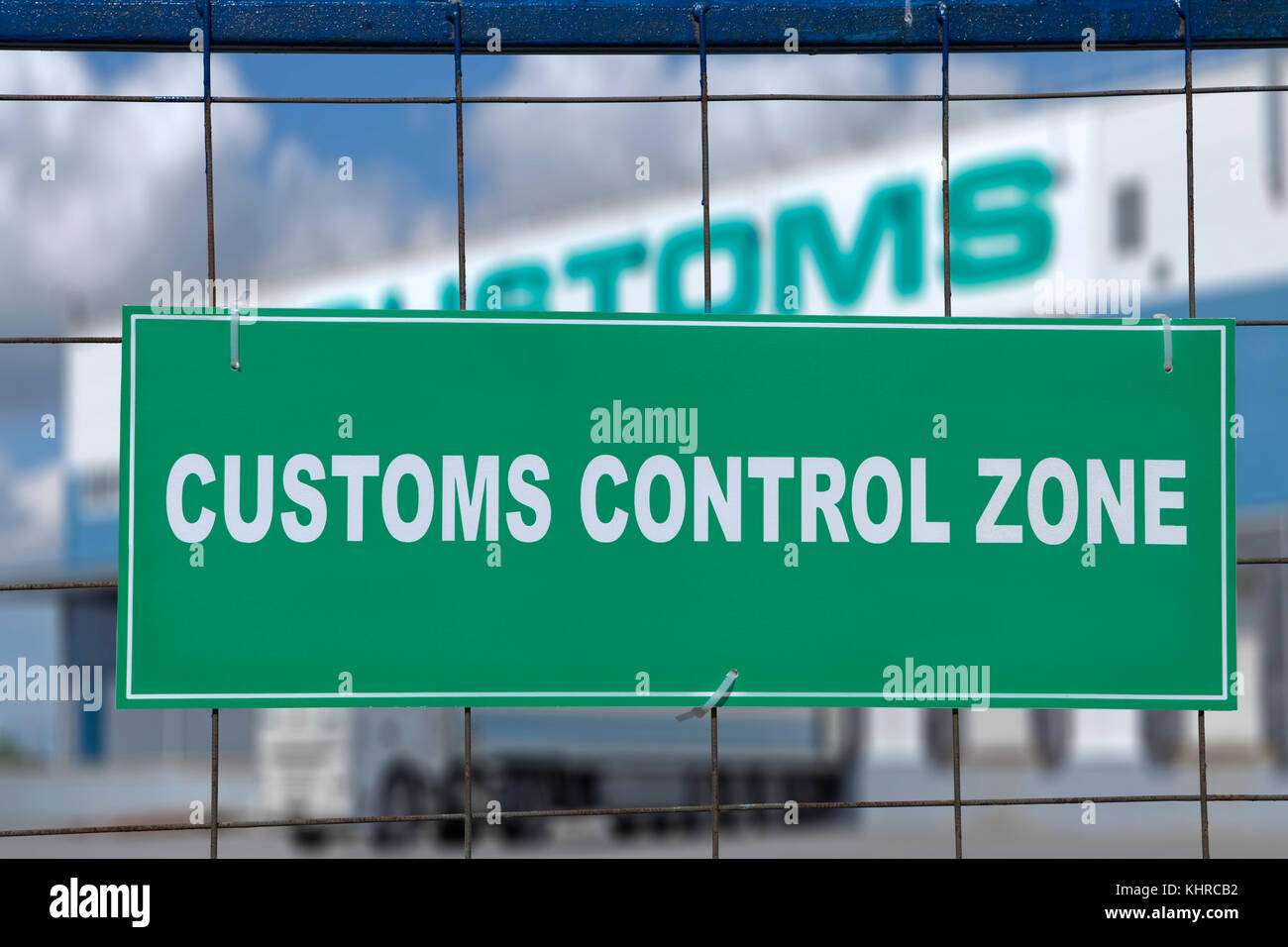 Logistics complex behind the green sign, customs control zone. - Stock Image